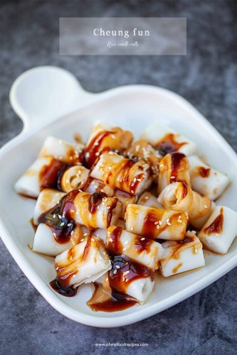 rice noodle rolls cheung fun with sauce on a white plate
