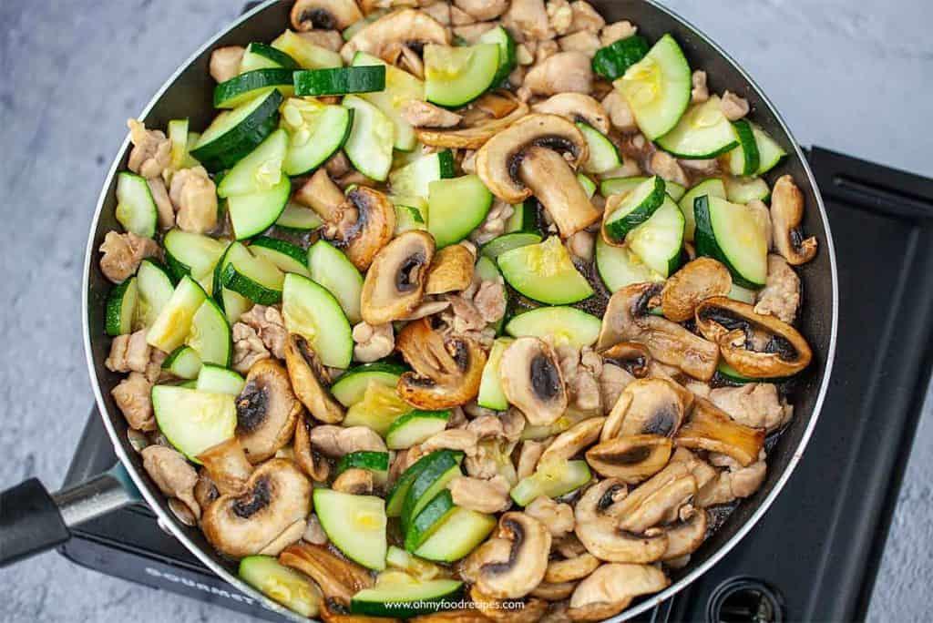 stir fry zucchini mushroom chicken in a pan