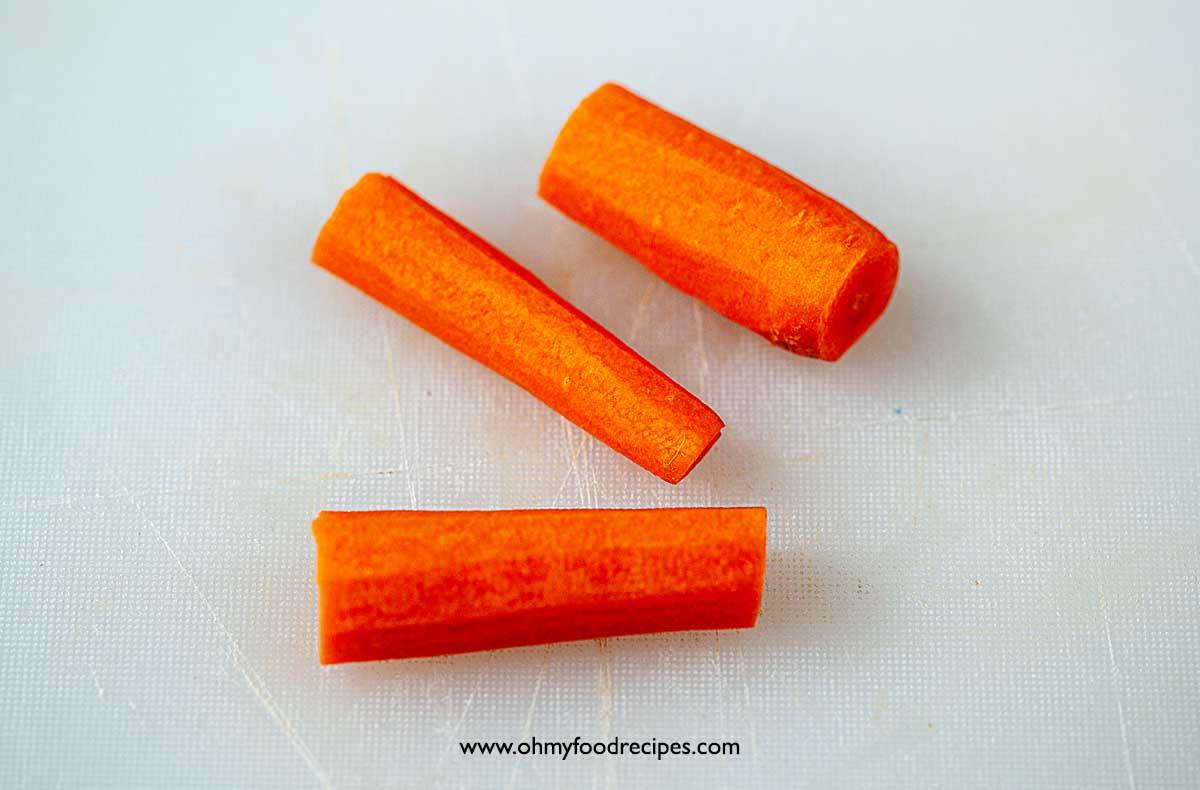 peeled and cut carrots into 3 chunks
