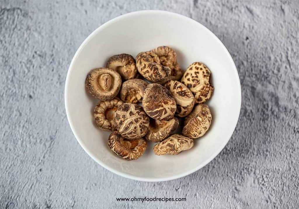 dried Chinese black mushrooms in a white bowl