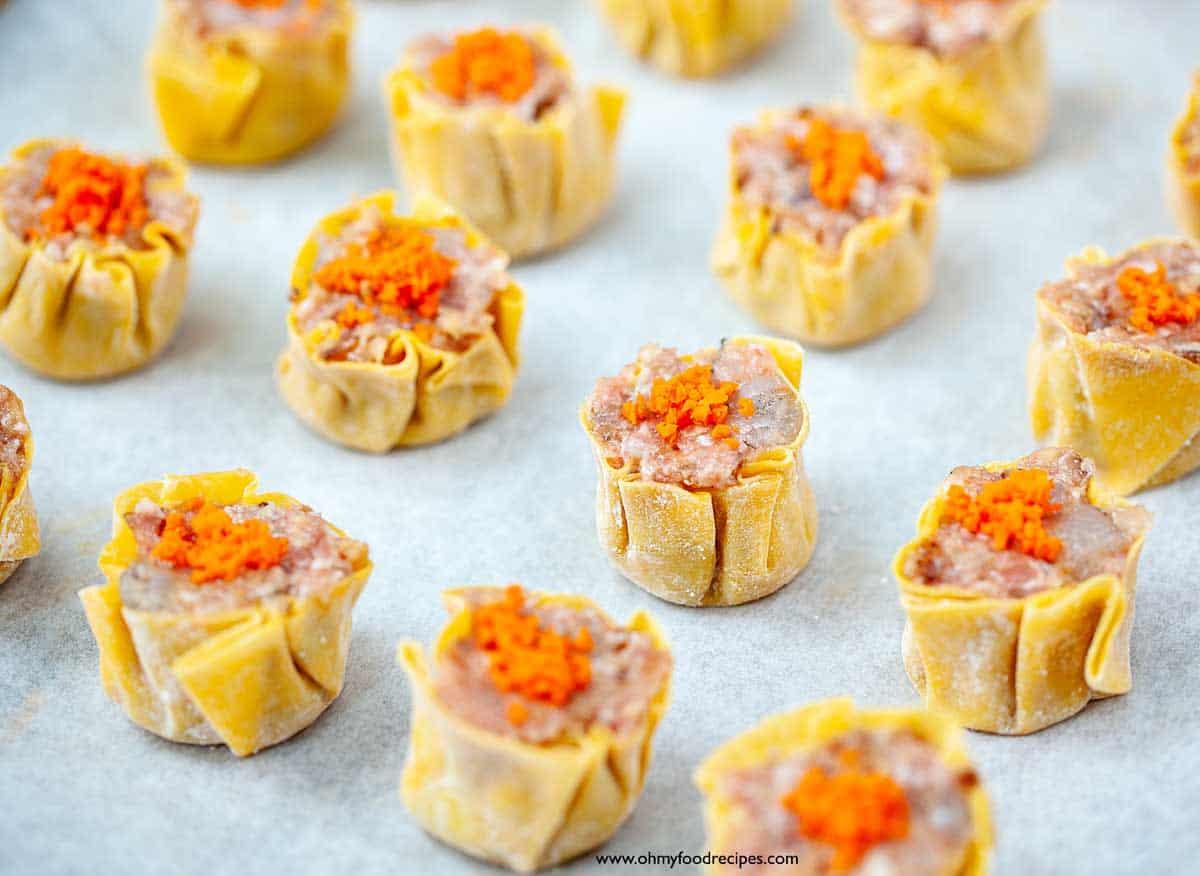 chopped carrot on top of siu mai