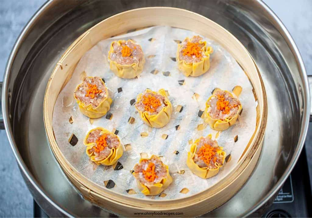 shumai or siu mai in a steamer with a bamboo basket