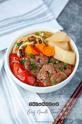 Taiwanese beef noodle soup with chopstick on a side