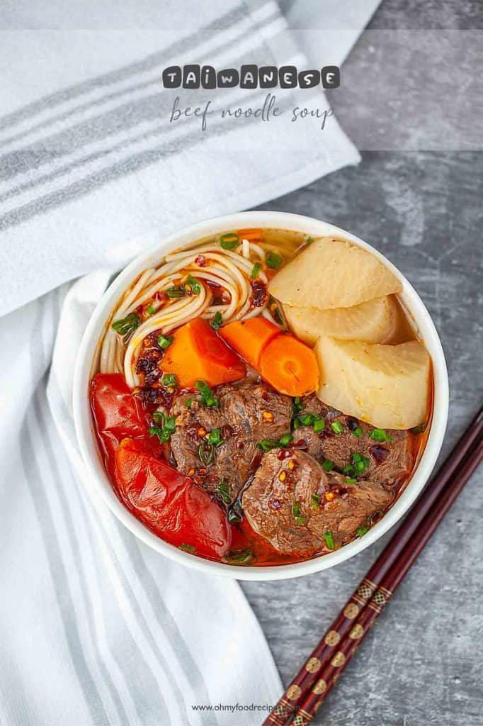 Taiwanese beef noodle soup top view with chopsticks