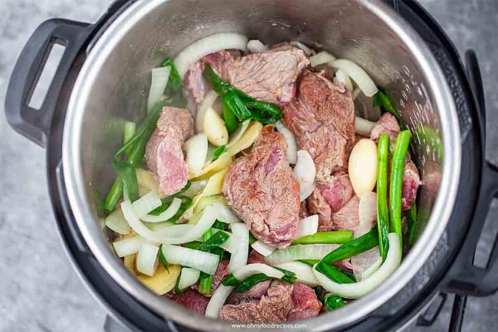 browning the meat both sides in the pressure cooker for Taiwanese beef noodle soup
