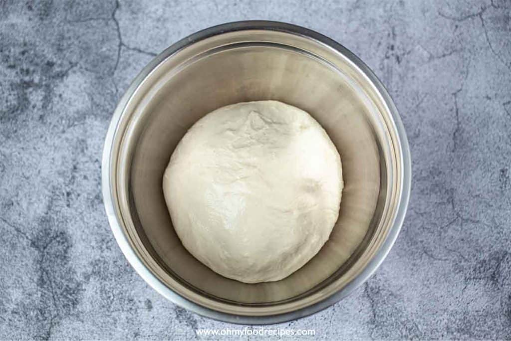 Dough rises in the mixing bowl