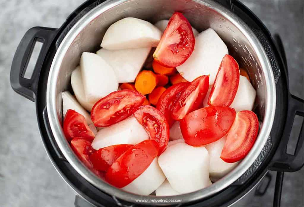 tomatoes carrot and daikon added into the instant pot