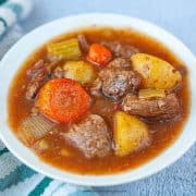 cooked beef stew in a white bowl horizontal