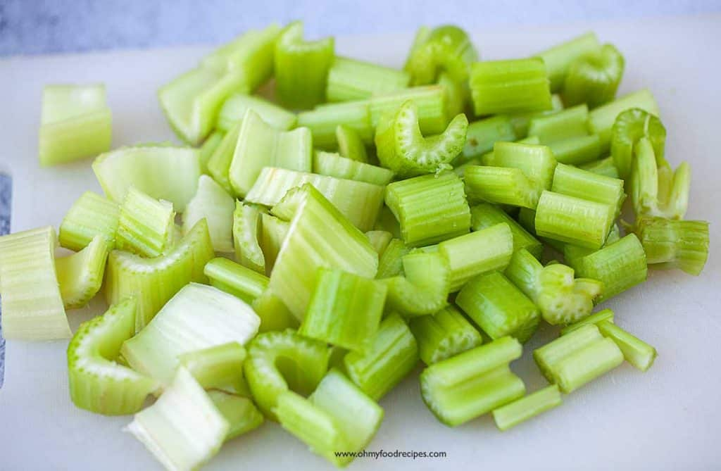 celery cut up on the chopping board