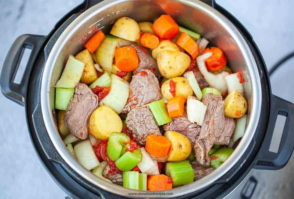 uncooked beef stew mixed vegetables and beef in instant pot