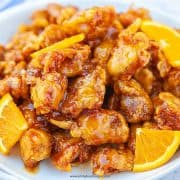 Chinese takeout orange chicken with orange slices