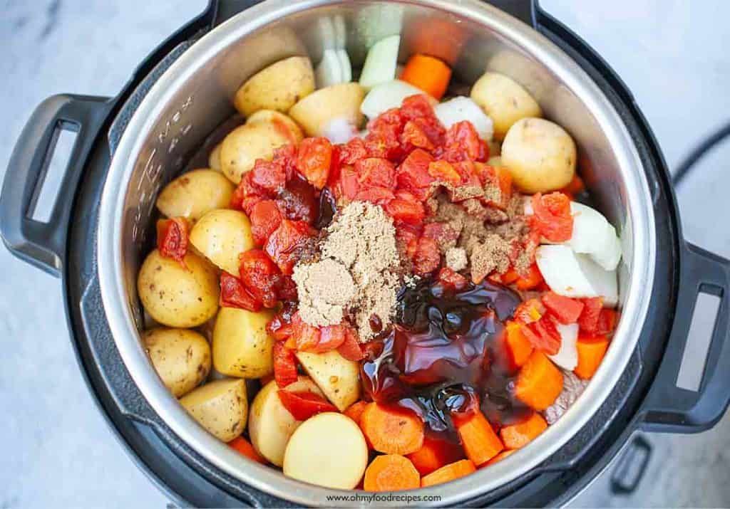 beef stew sauce and vegetables in pressure cooker