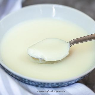 a scoop of ginger milk pudding on a silver spoon