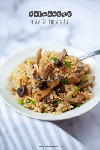 Taiwanese sesame oil chicken rice on a silver spoon