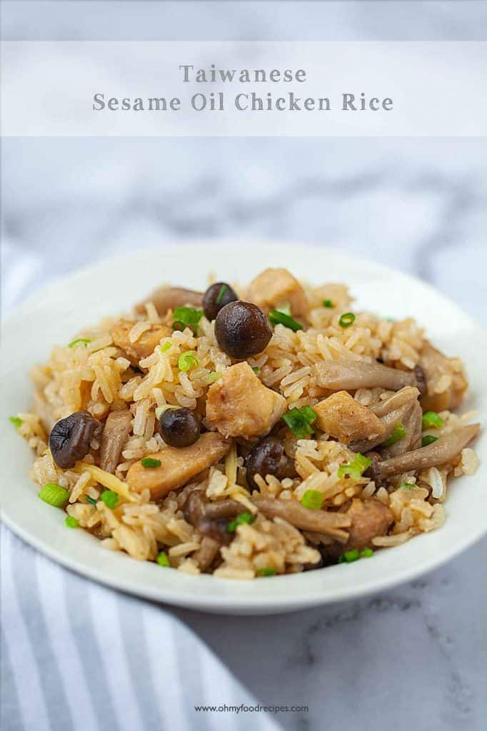 Taiwanese sesame oil chicken rice in a white bowl with a striped gray towel