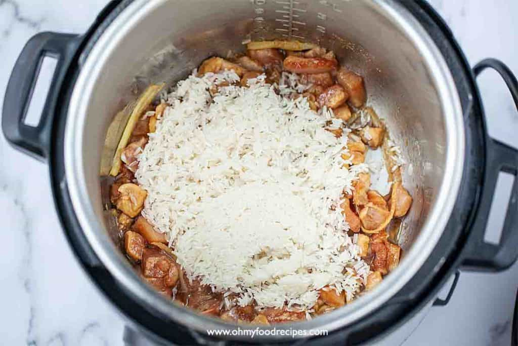 rice add into the chicken in instant pot