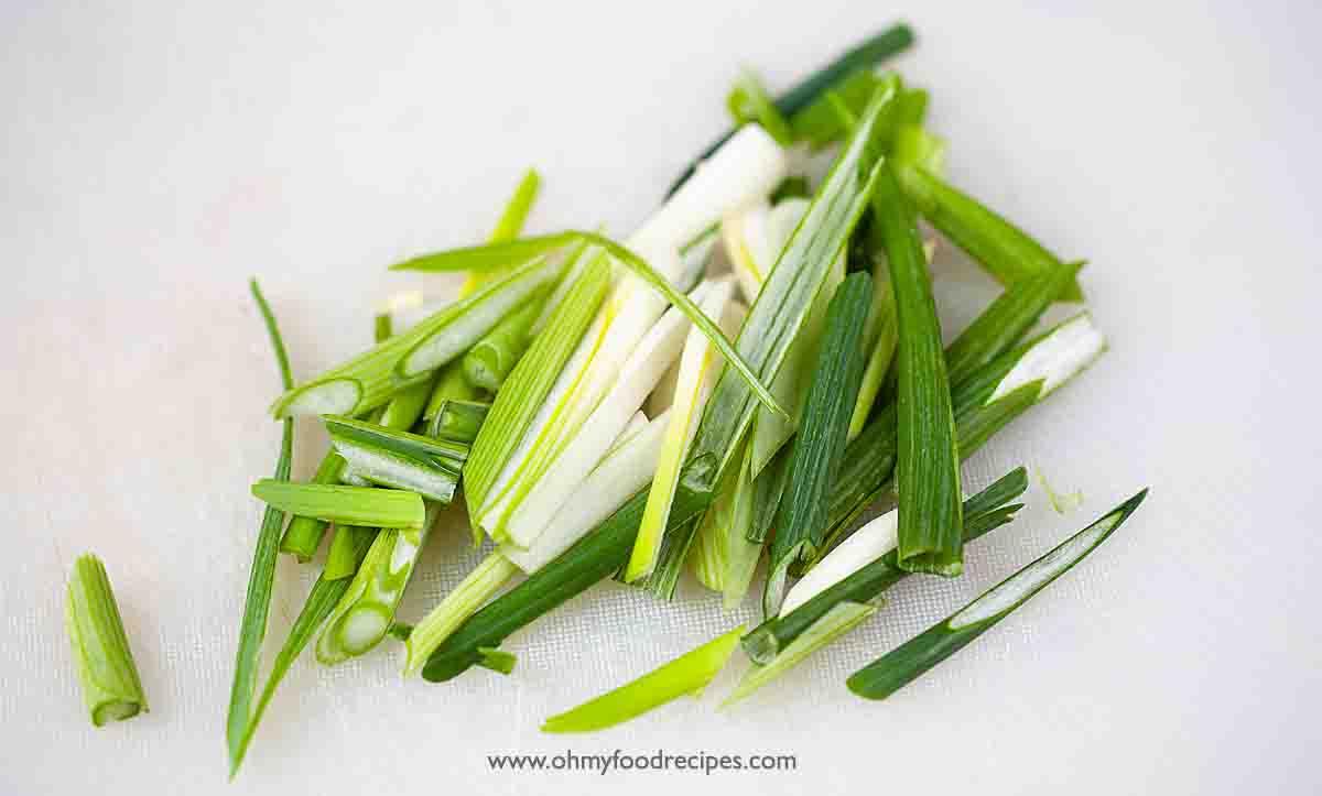 Green onion cut on the chopping board