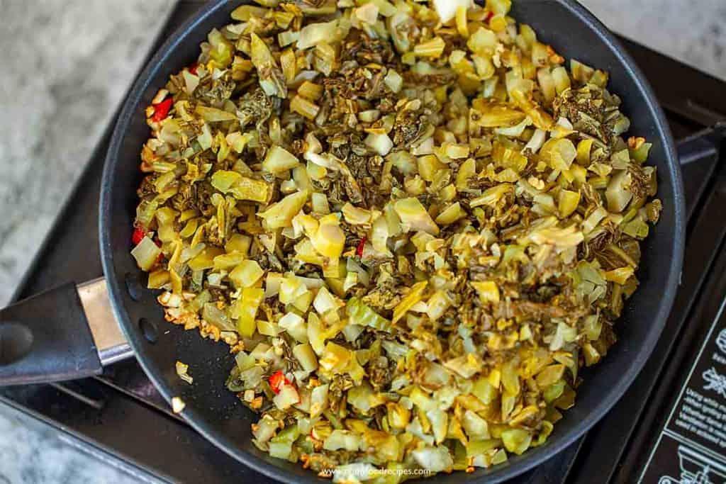 stir fry suan cai in the pan