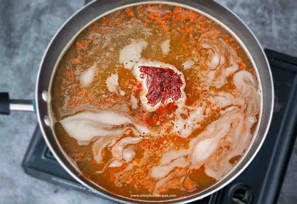 chili paste with soup base in the pan