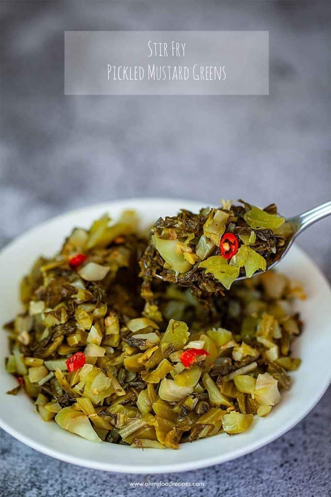 stir fry pickled mustard greens on a sliver spoon