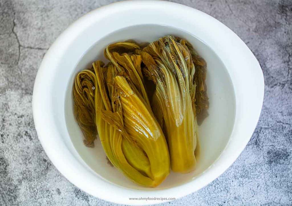 suan choy soaking water in a bowl