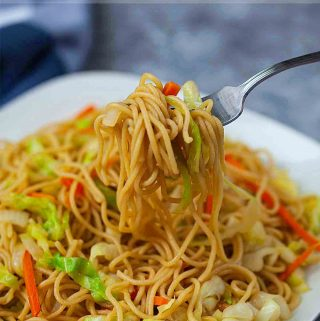 vegetable chow mein on a silver fork
