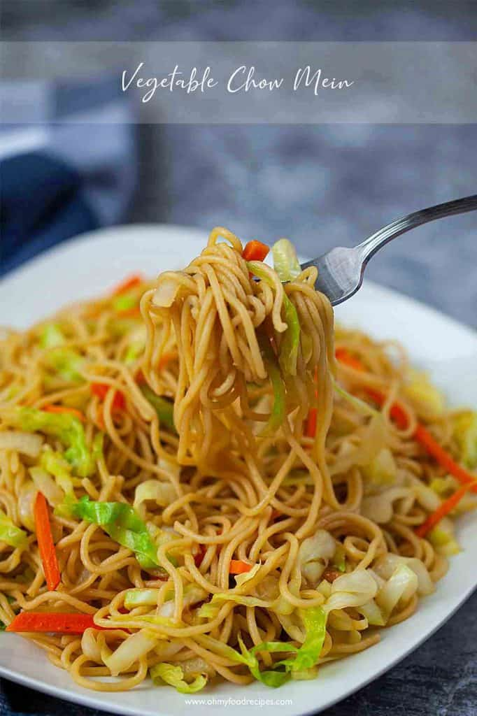 Chinese vegetable chow mein on a silver fork