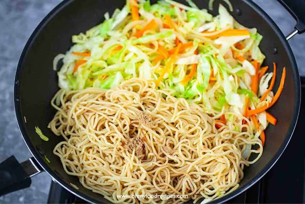 noodles and vegetables stir fry in the wok