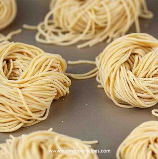 fresh homemade ramen noodles on the golden tray