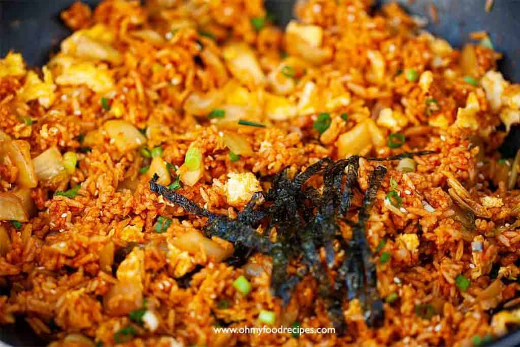 Nori strips added into kimchi fried rice in the wok