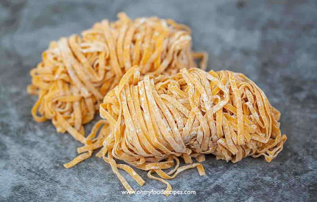 two fresh wide Chinese egg noodles