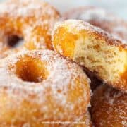 homemade sugar donuts with a bite one the donut