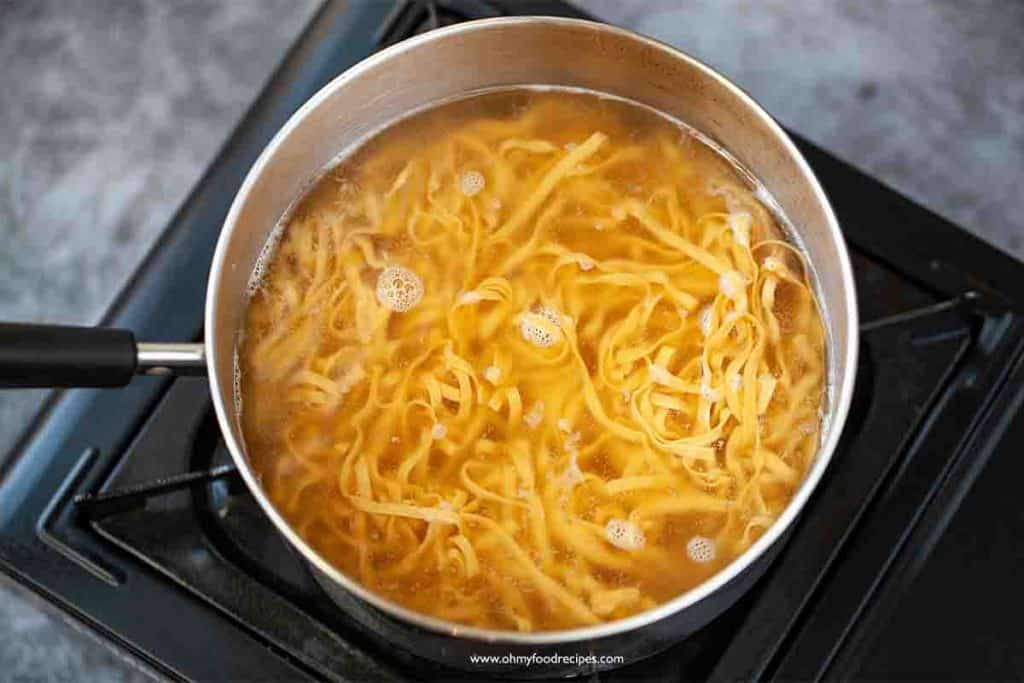 cooking noodles in the pot with water