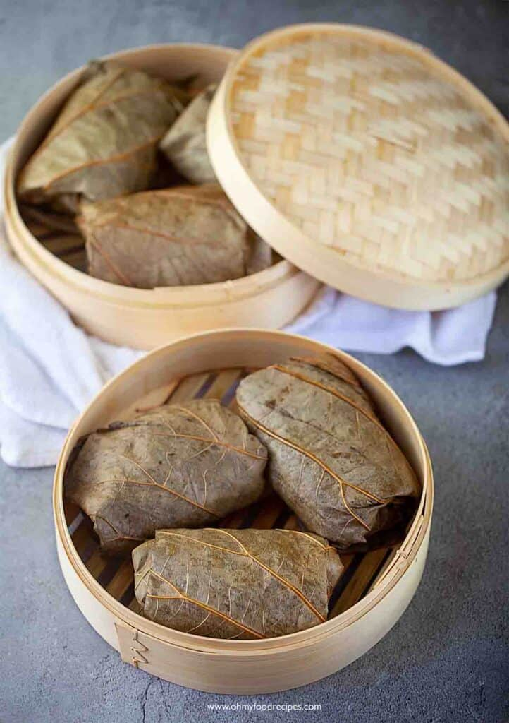 Lo mai gai glutinous rice wrap with chicken in lotus leaves in bamboo basket