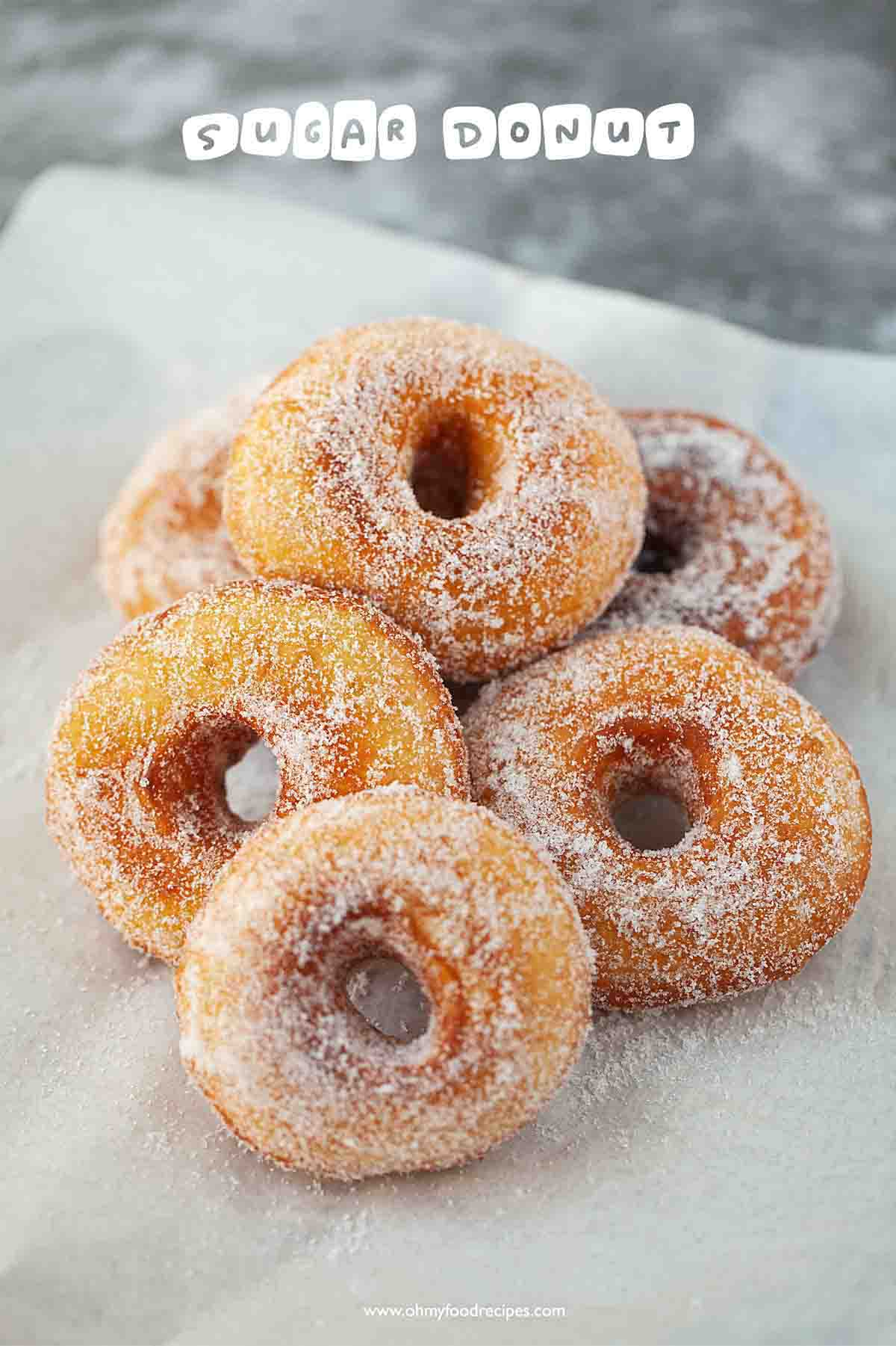 homemade sugar donuts with holes in the middle