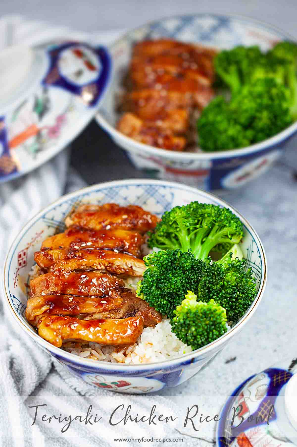Japanese teriyaki chicken rice bowls with gray striped towel
