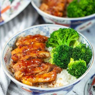 Japanese chicken teriyaki rice with broccoli in the bowls