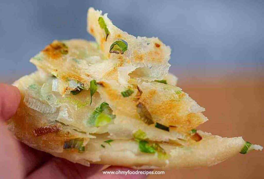layers flaky cong you bing Chinese scallion pancake on hand