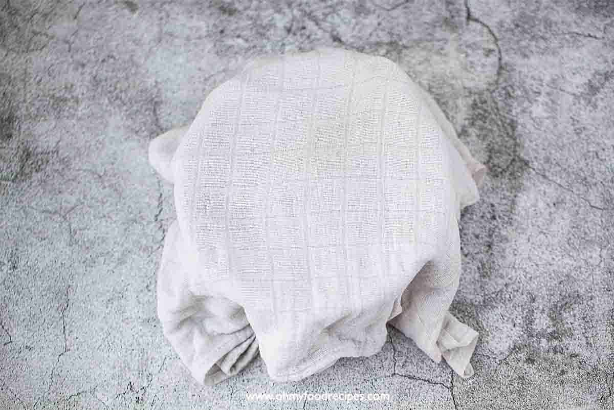 dough in the bowl cover with a cloth