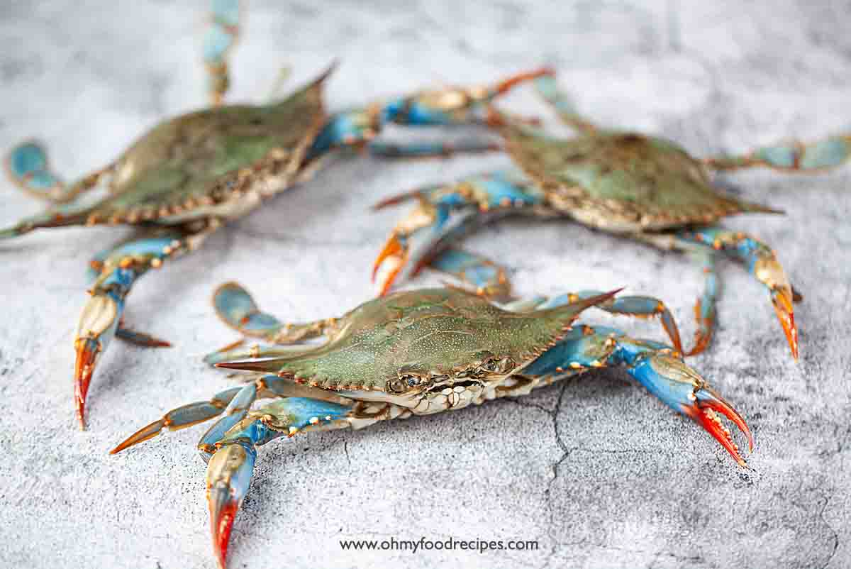 three alive blue crabs
