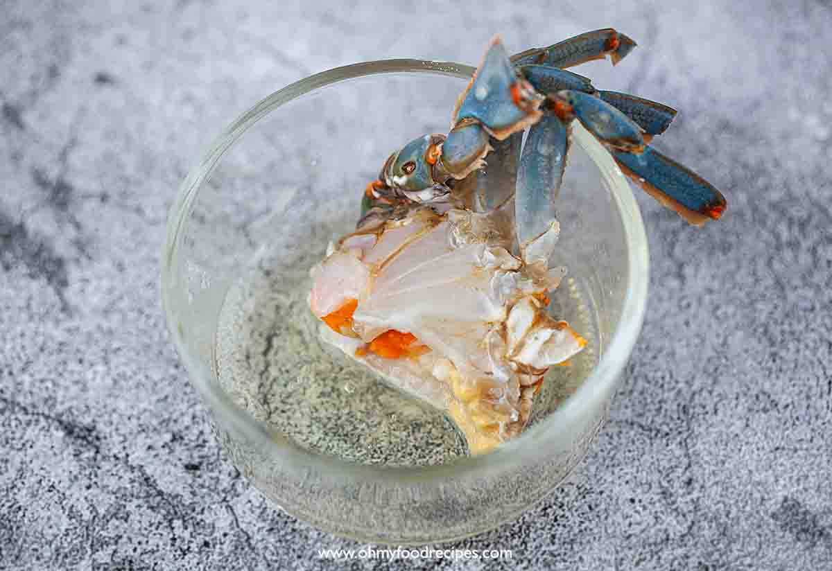 crab leg part dipping into the egg white