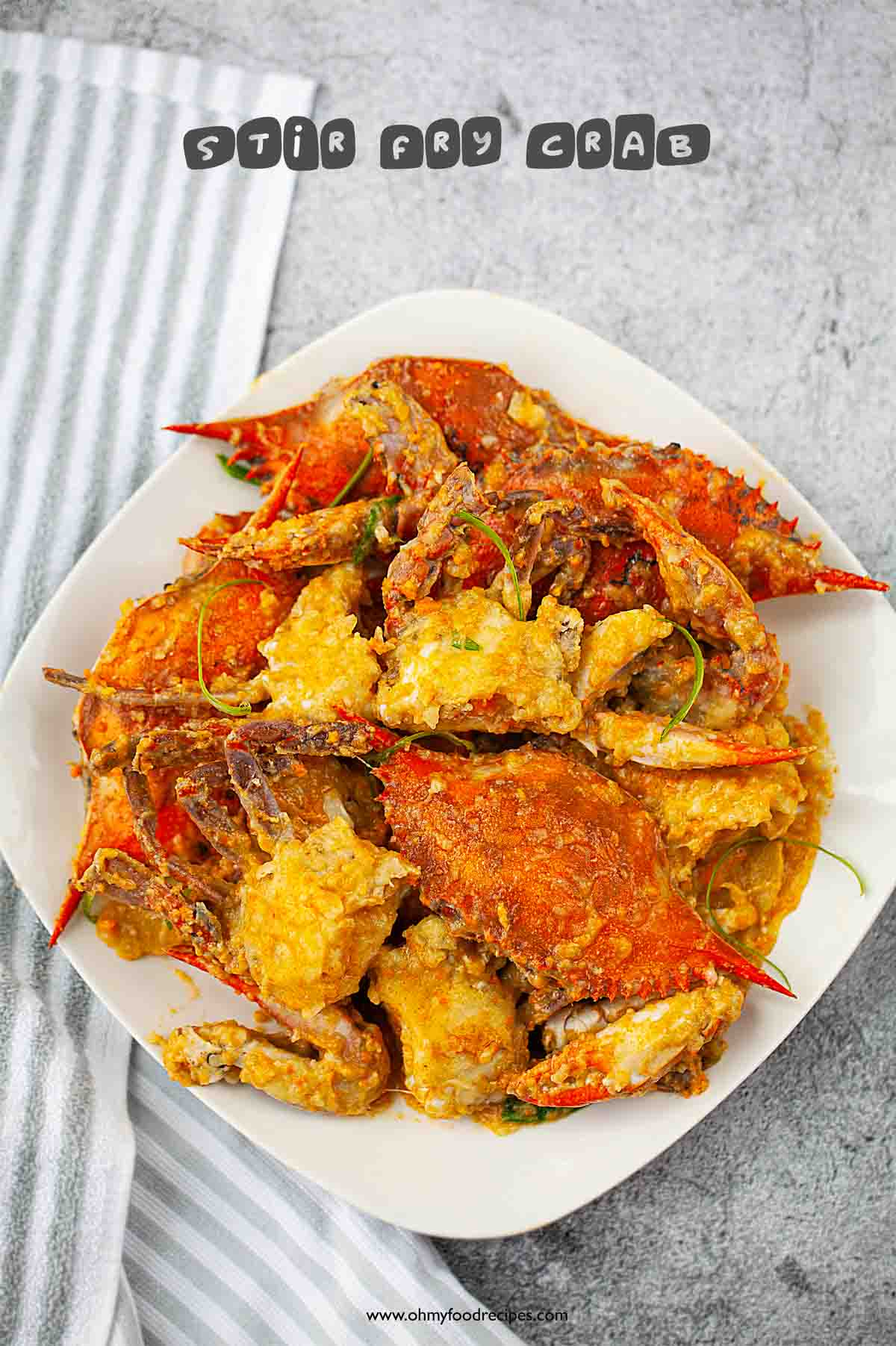 top view of blue crab stir fry with ginger and scallion