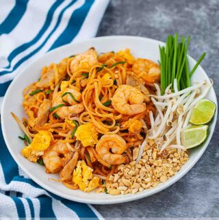 Easy homemade pad thai noodles on a white plate